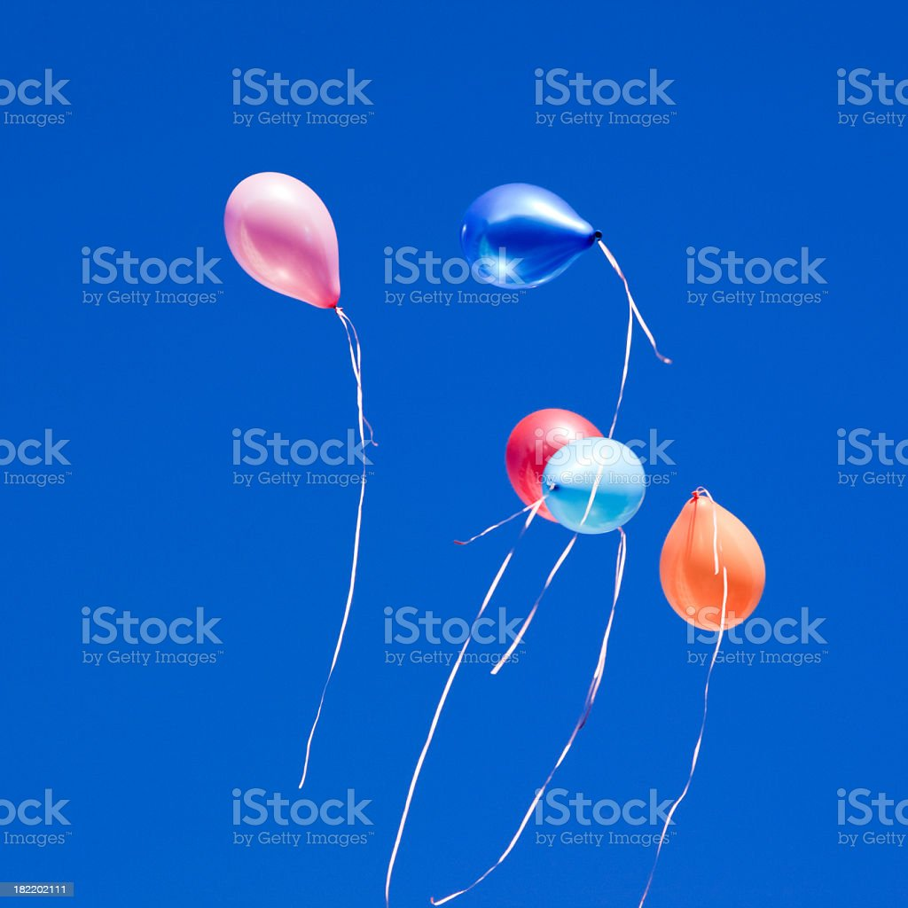 Flying multicolored ballons royalty-free stock photo
