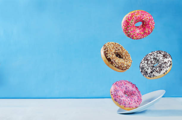 Flying multicolored donuts stock photo