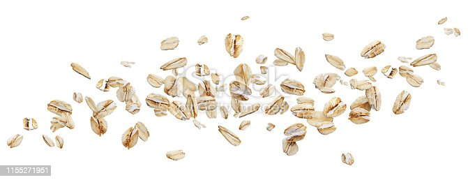Flying oat flakes isolated on white background with clipping path, falling oats collection, top view