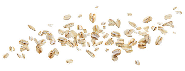 flying oat flakes isolated on white background with clipping path - aveia alimento imagens e fotografias de stock