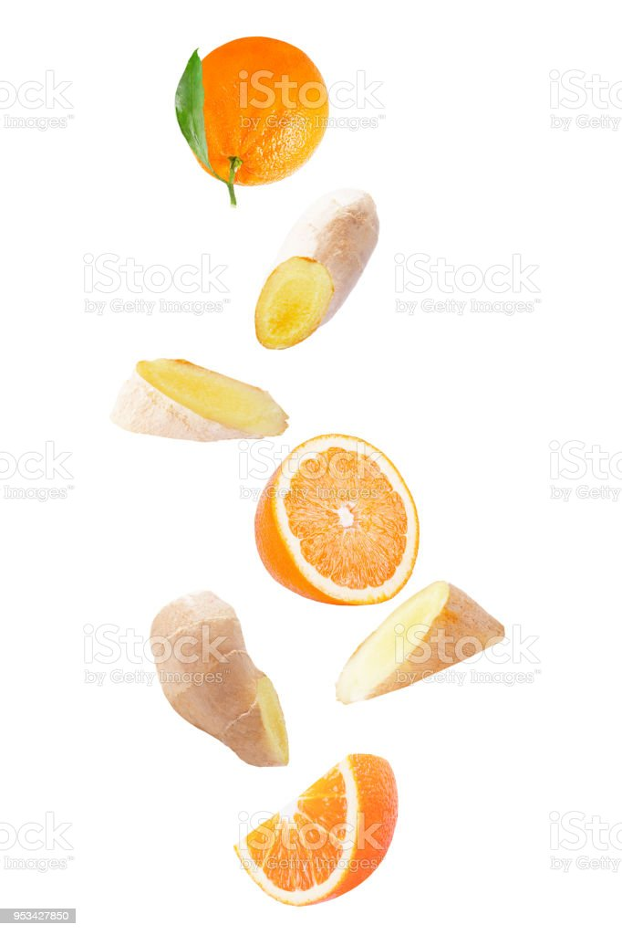 Flying orange fruit and ginger root isolated on white background with clipping path - foto stock