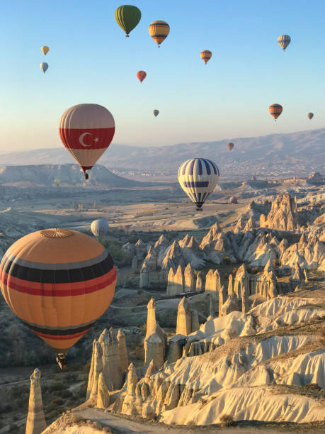 Flying over Cappadocia in a hot air balloon Flying over Cappadocia in a hot air balloon turkish stock pictures, royalty-free photos & images