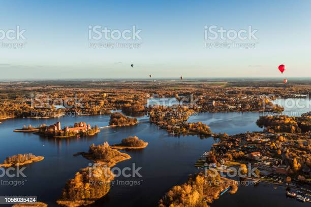 Photo of Flying over castle lake hot air balloon