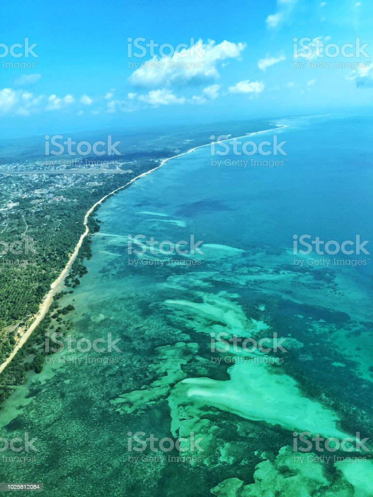 Flying over coral  reef at Mafia Island, Tanzania stock photo