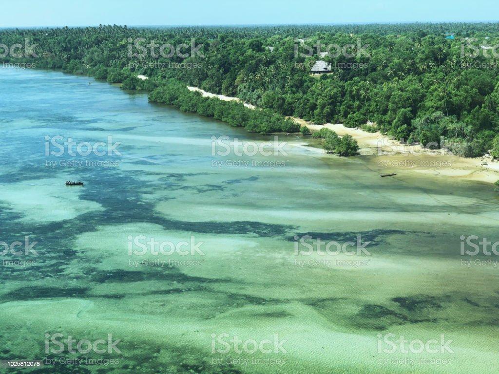 Flying over coral  reef at Mafia Island, Tanzania stock photo