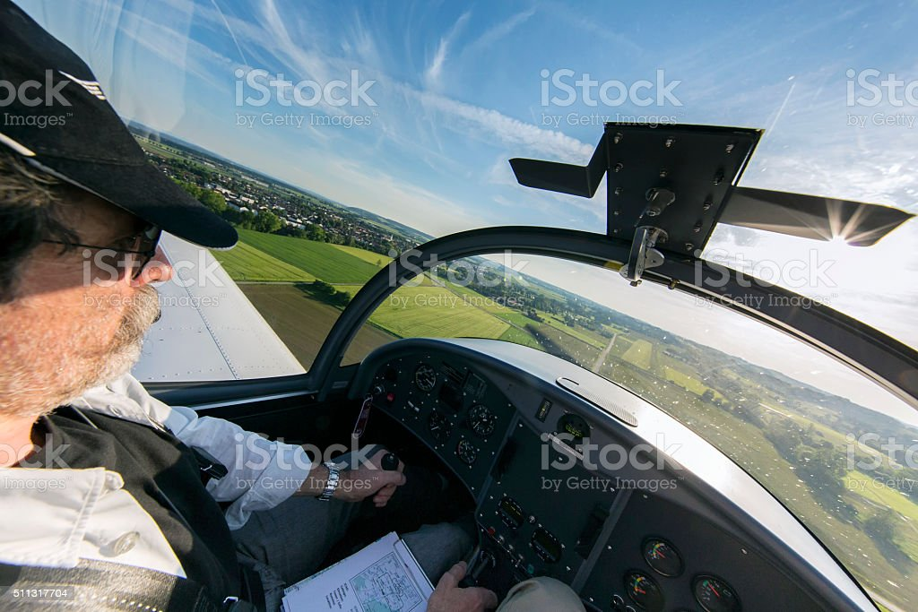 Flying over country - view from the cockpit stock photo