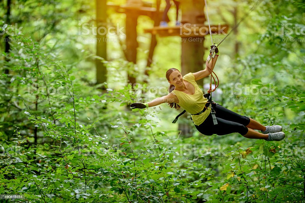 flying over forest with zip line stock photo