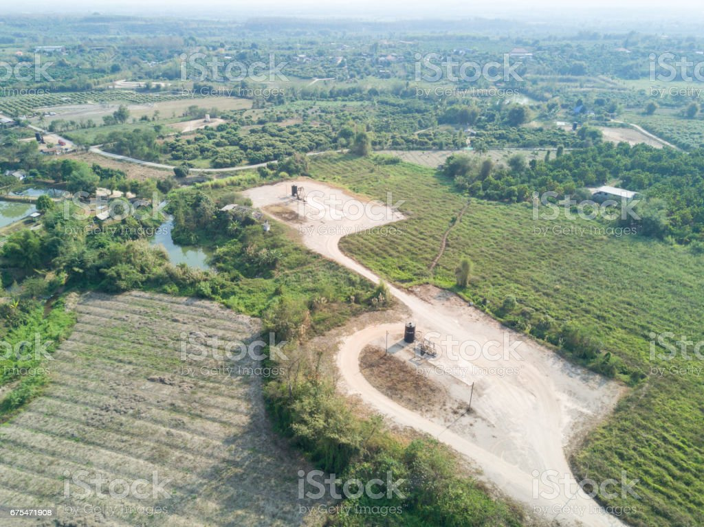 Flying over oil beam pumps (Sucker Rod) in the country side. stock photo