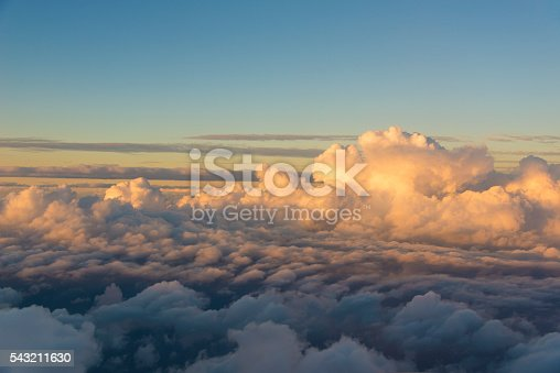 istock Flying over the clouds at sunset 543211630