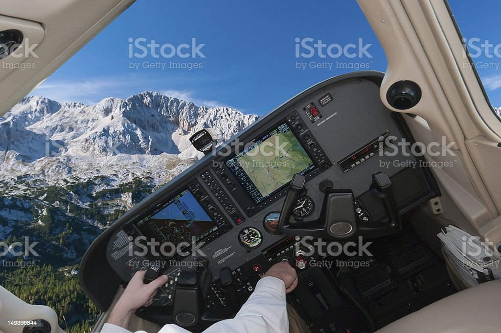 Flying over the mountains stock photo