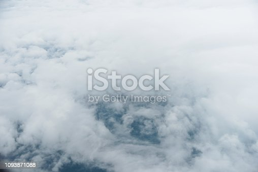 istock Flying over the white fluffy clouds 1093871088