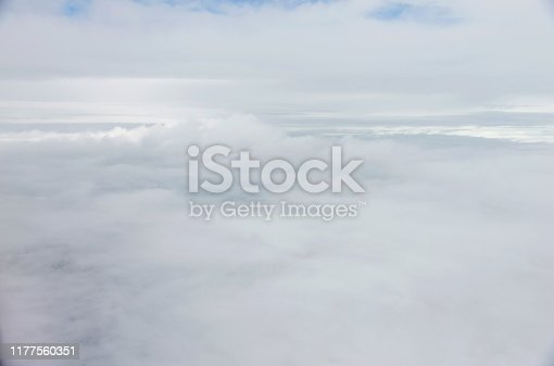 878607638 istock photo Flying over the white fluffy clouds 1177560351
