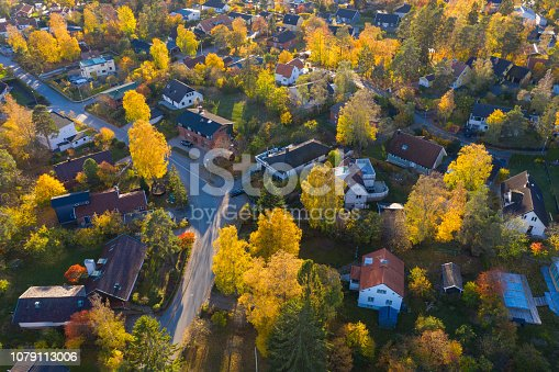 Flying over villa and tree area just at sunset