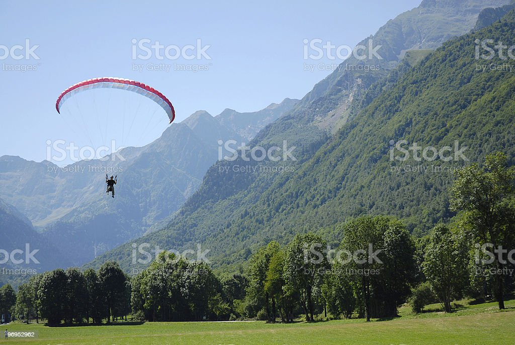 Flying paraglider in the mountain royalty-free stock photo