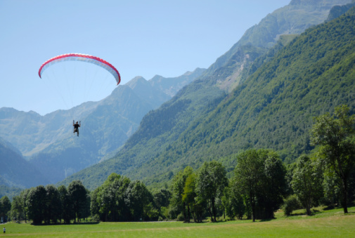 Flying Paraglider In The Mountain Stock Photo - Download Image Now