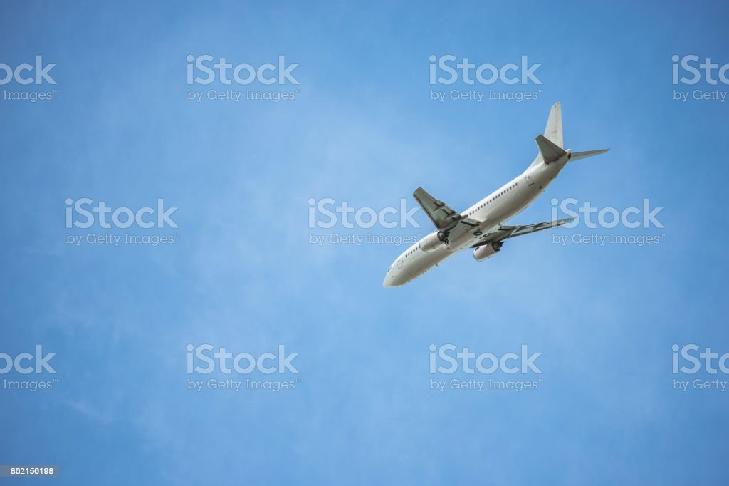 Flying passenger plane stock photo