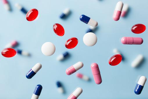 flying pill tablet capsule levitation medicine. medical treatment for disease flu virus