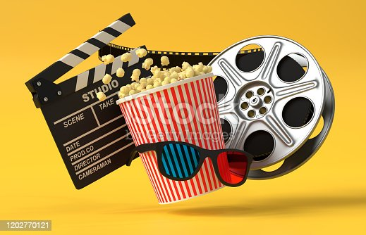 956942702 istock photo Flying popcorn, 3D glasses, film reel and clapboard on a yellow background 1202770121