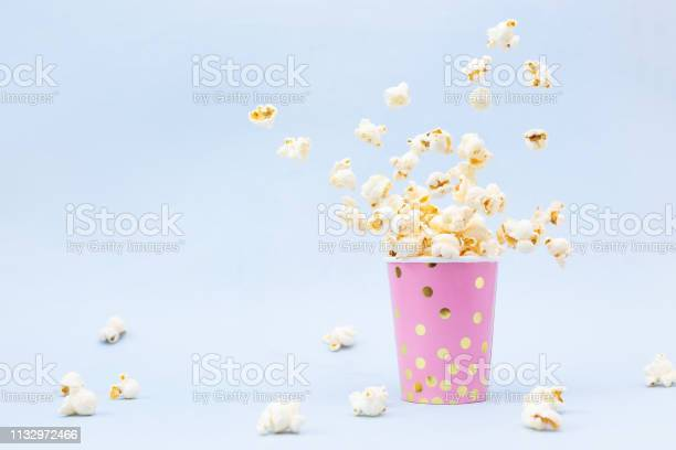Flying popcorn in a bright glass and on a blue background picture id1132972466?b=1&k=6&m=1132972466&s=612x612&h=x8rkogshad2i1tgowh1shxllc6n 21rzivff79ovioa=