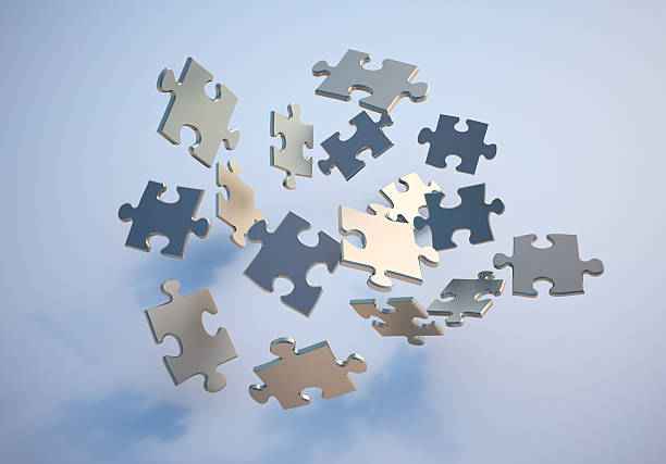 Flying puzzle pieces stock photo