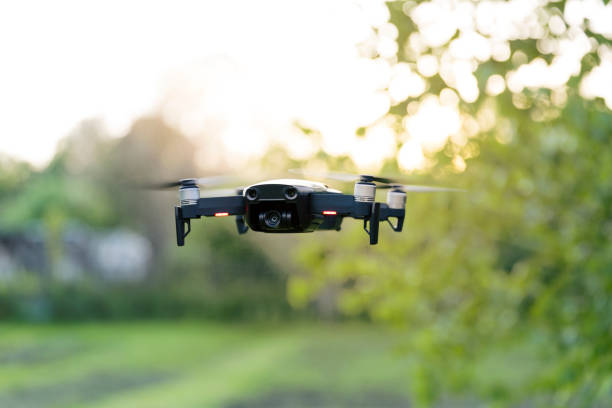 flying quadrocopter, remote controlled drone with camera - drones stock photos and pictures
