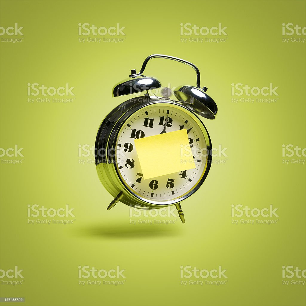 Flying retro alarm clock with sticky note royalty-free stock photo