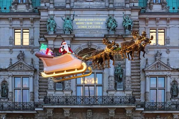 Flying Santa Claus at Hamburg Town Hall Christmas market, Germany stock photo