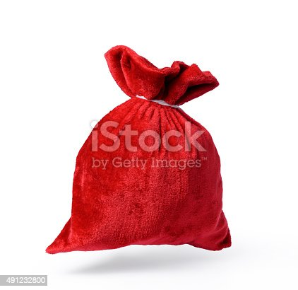istock Flying Santa Claus red bag full, on white background 491232800