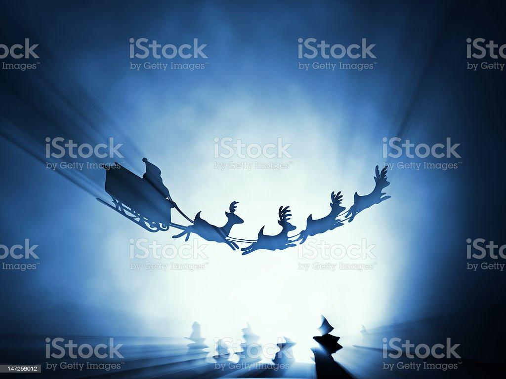 flying santa sledge stock photo