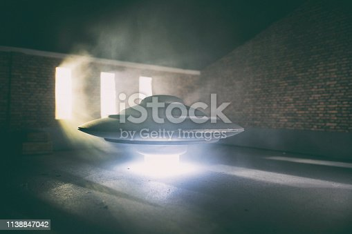The stuff of sci-fi dreams, a pulsating UFO hovers in an old industrial garage, its plasma engine keeping it off the ground.