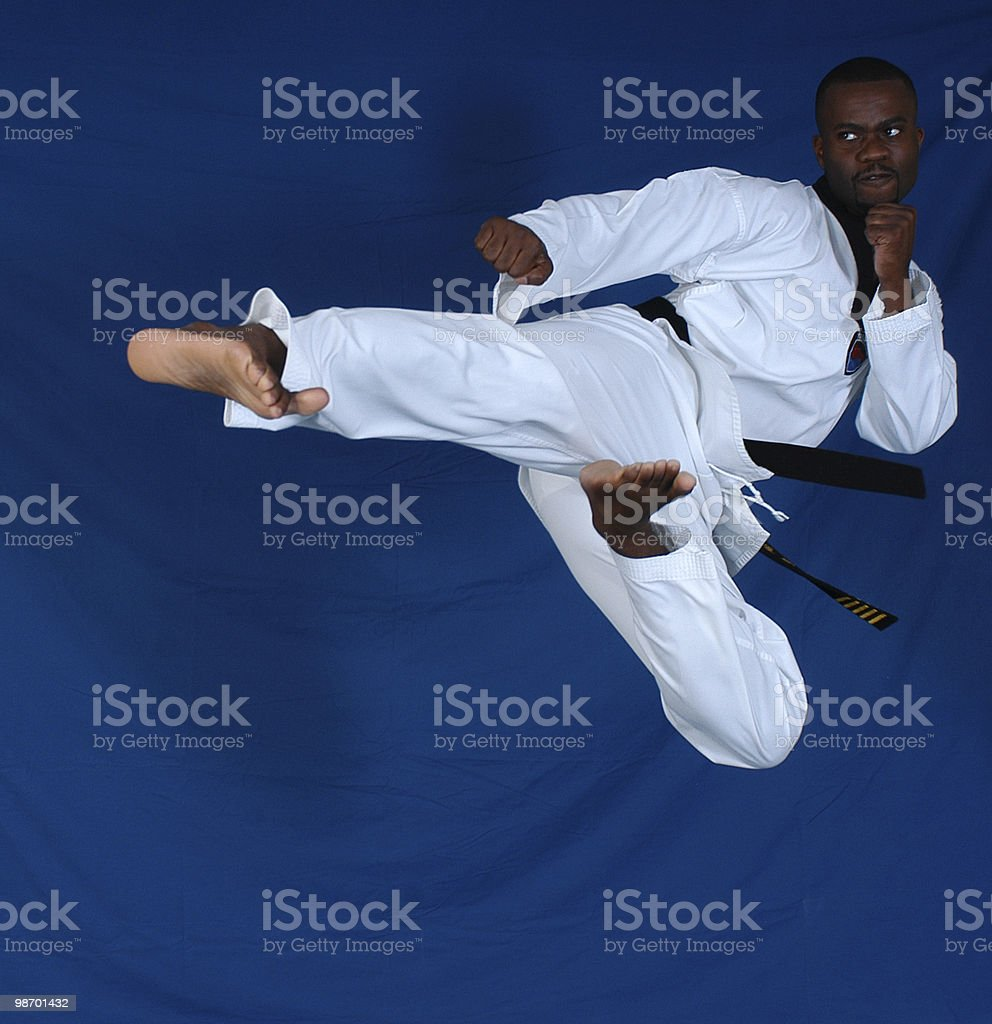 Flying side kick royalty-free stock photo