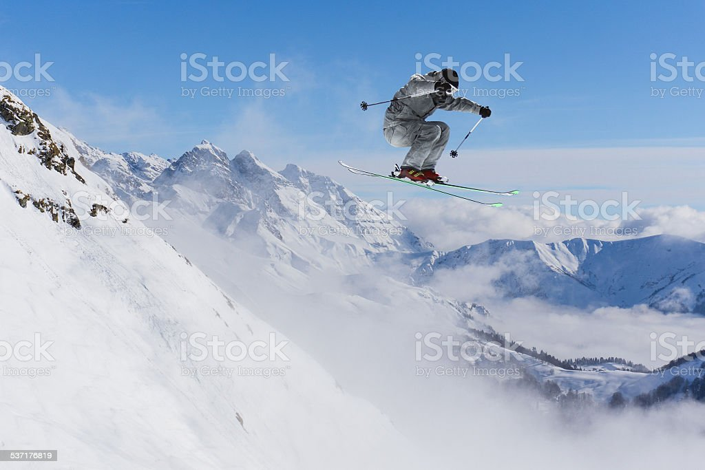 Flying skier on mountains stock photo