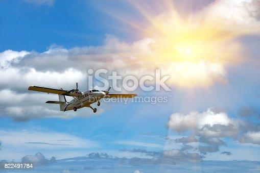 Flying small passenger propeller plane in flight on a lovely sunny day