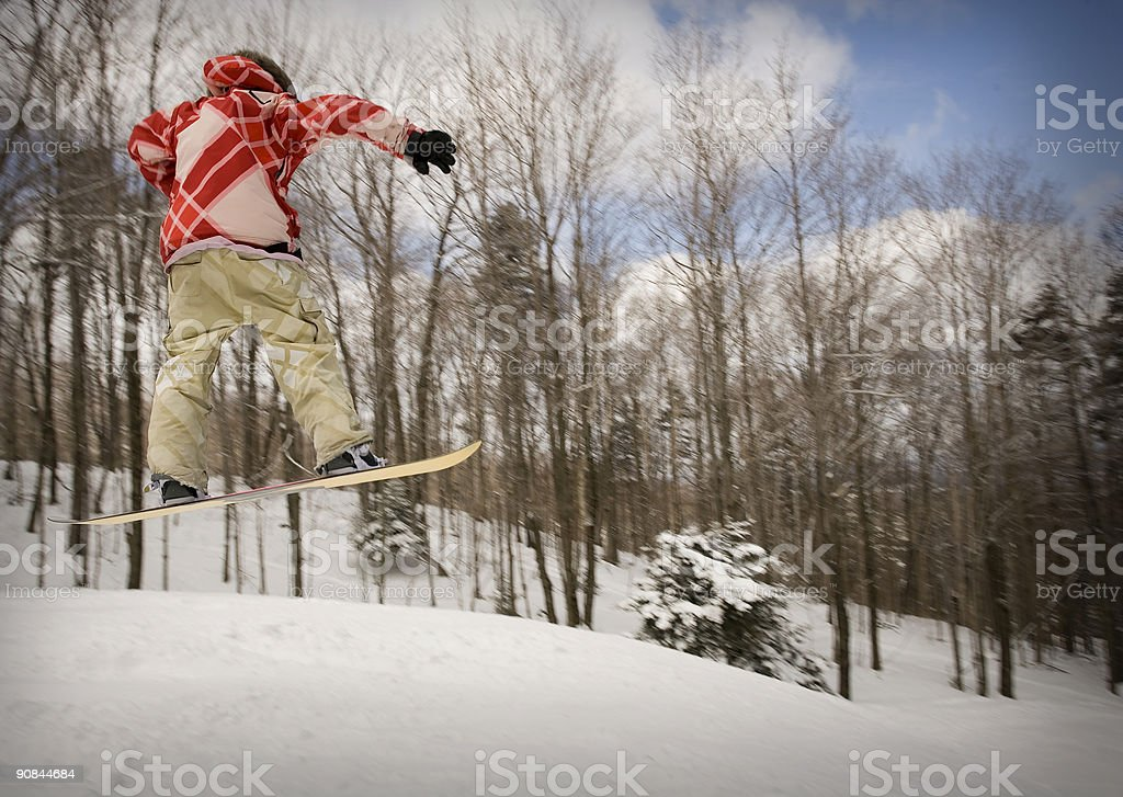 Flying snowboarder stock photo