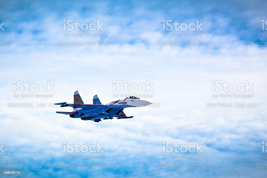 Flying Su-27 of Russian Knights aerobatic team royalty-free stock photo