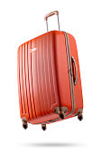 Studio shot of a flying orange suitcase