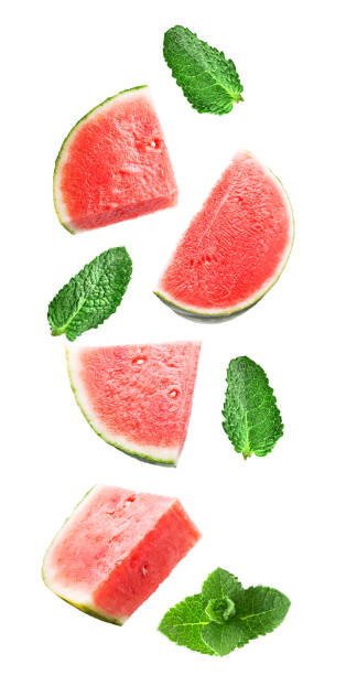 Flying sweet watermelon and mint isolated on white stock photo