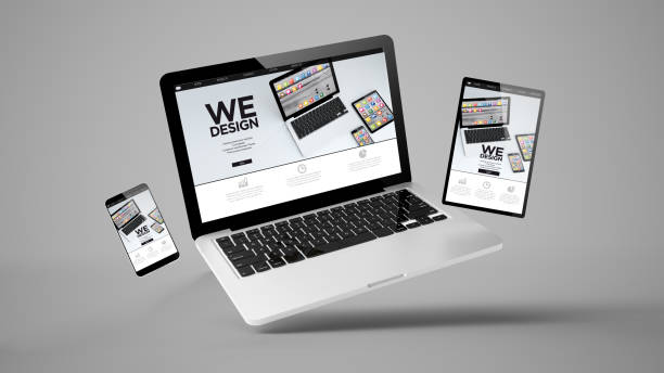 flying tablet, laptop and mobile phone showing mobile design website stock photo