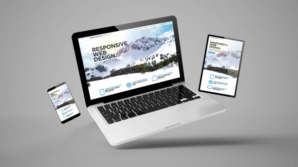 flying tablet, laptop and mobile phone showing responsive web design stock photo