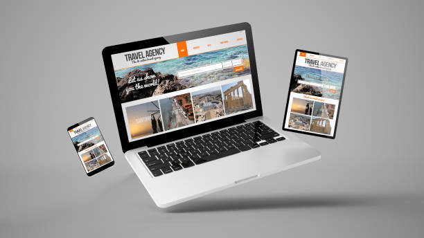 flying tablet, laptop and mobile phone showing travel agency responsive web design stock photo