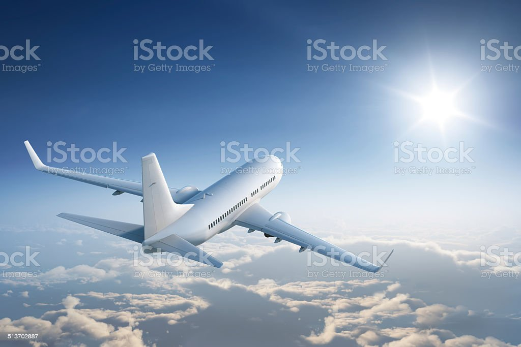 Flying towards the sun stock photo