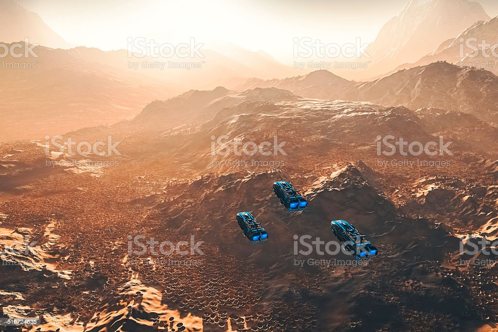 Flying UFOs over strange alien landscape stock photo
