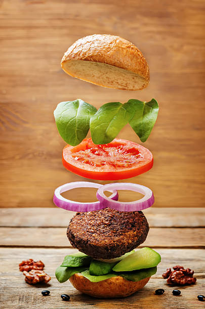 Flying vegan black bean mushrooms burger stock photo
