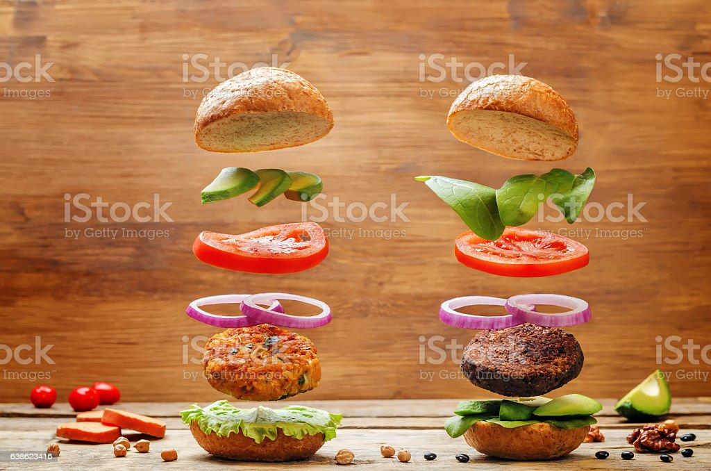 Flying vegan sweet potato and black bean mushrooms burgers stock photo