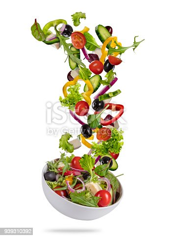 Flying vegetable greek salad isolated on white background. Healthy eating and lifestyle. Very high resolution image