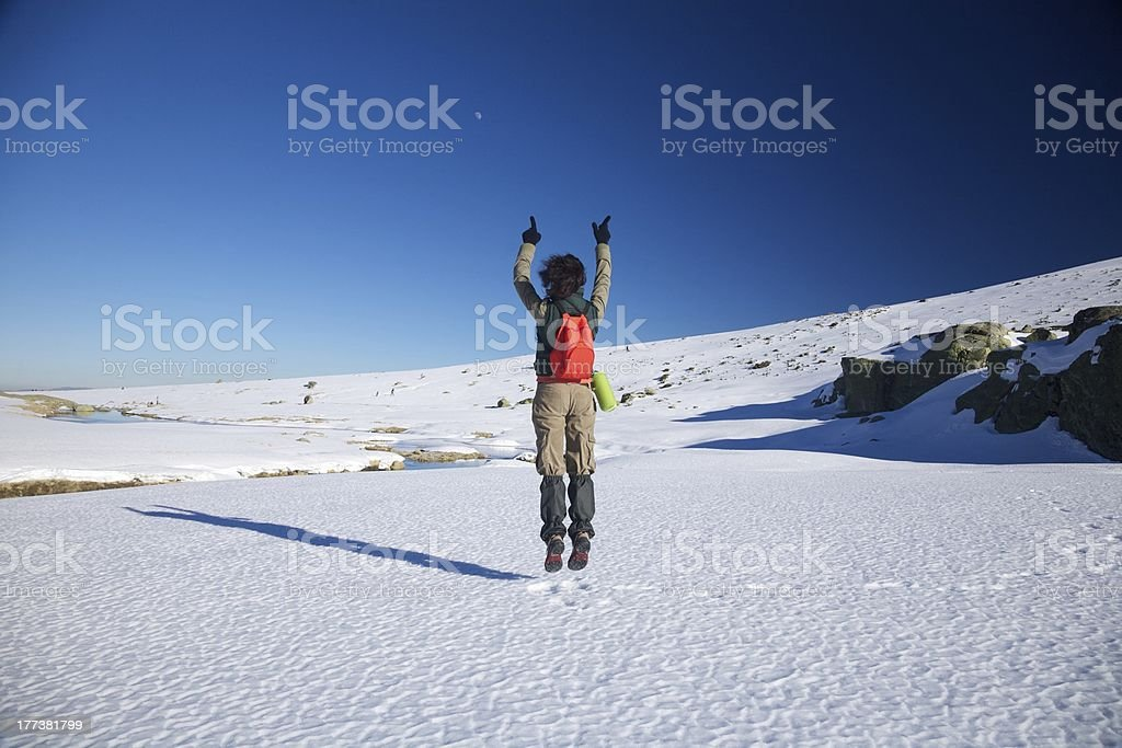 flying winter hiking woman stock photo
