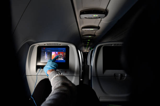 Flying with protective gloves during coronavirus pandemic stock photo