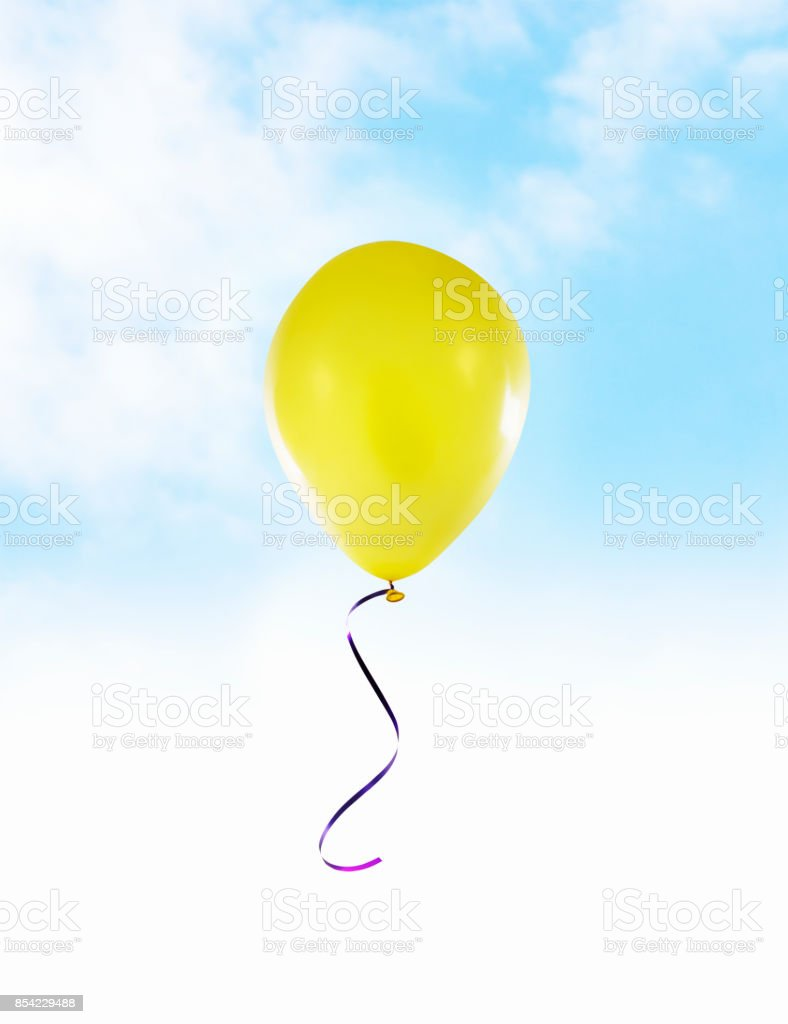 Flying Yellow Balloon stock photo