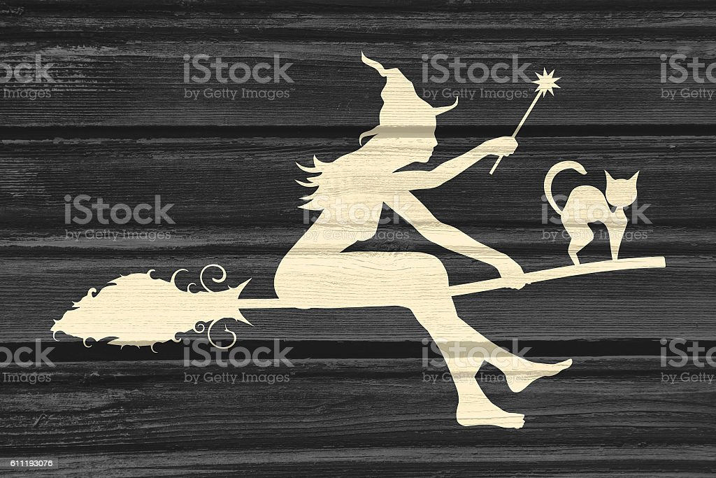 Flying young witch icon. Witch silhouette on a broomstick stock photo
