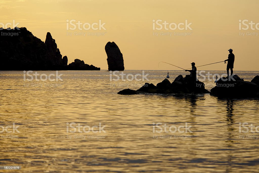 Flying-fishing at sunset stock photo